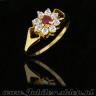 Gold ring with zircons