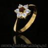 Gold ring with granade and zircons